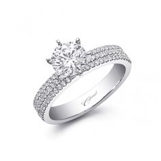 This elegant Charisma engagement ring features three rows of petite prong set diamonds on the shoulders of the ring.