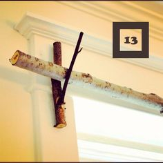 build a curtain rod and brackets. 50 uses for branches and logs. Great blog post!