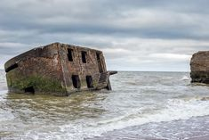 An old military fort slowly sinks into the sands along the Baltic Sea coast by the port city of Liepaja on Latvia's west coast Casco Bay, Travel News, Baltic Sea, West Coast, Bangkok, Monument Valley, Military, Boat, Sands