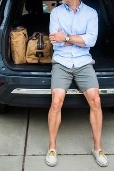 Men's Light Blue Long Sleeve Shirt, Grey Shorts, White Plimsolls, Tan Canvas Duffle Bag