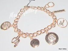 GUESS ??? Jeans Rhinestones  Logo Bangle  Bracelet  Rose Gold Tone Charms    NWT was $47 sold $29