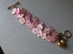 """prettynpink"" button bracelet for the BCFO benefit gala silent auction Fri July 26th 2013 ... vintage shell buttons on a Juicy couture charm bracelet !!!!"
