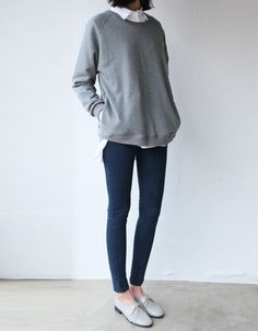 I like this -- the oversized sweater and button down underneath with skinnies…