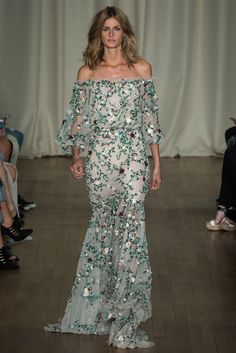 With yesterday marking the start of Coachella we couldn't help but take a look at the Marchesa Spring 2015 Collection for some free-spirited, festival bride inspiration.