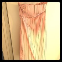 Express Strapless Pencil Dress Express Baby Pink Strapless Dress with Black vertical stripes. Stretchy material makes it feel light and comfy!! Knee length with slit in the back! Adorbs with black blazer & pumps!!! Express Dresses Strapless