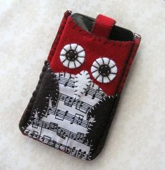 This owl cell phone holder is seriously cute! Maybe stamping the music onto white felt!