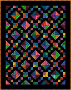 Pinned this quilt on a white background (which I prefer)...but there were no instructions, nor a name.  Jewel Box Quilt Pattern