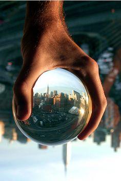 Big hand, little city by Brian Harris
