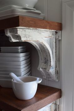 How to make your own corbels for open shelving. Tutorial here!