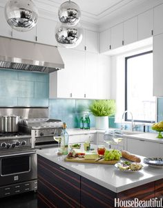Designer Kitchens - Pictures of Beautiful Dream Kitchens - House Beautiful -- Stainless steel hood option w/ cabinetry to ceiling.