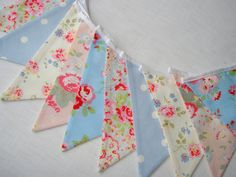 This is a lovely Shabby Chic Summery bunting in four Cath Kidston fabrics with the addition of powder blue Dotty by Clarke & Clarke. Perfect for