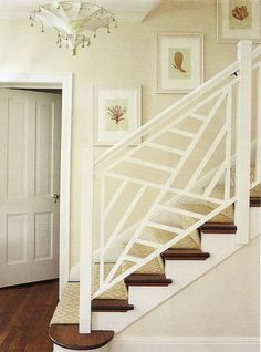 Chinoiserie fretwork baluster. Really like the wooden steps with the runner. Can get the wooden caps at Home Depot or Rona and paint or stain them to your liking.