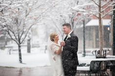 What an amazing wedding photo of the bride and groom dancing in the snow at their winter wedding.