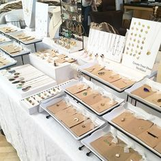 White and wood jewelry display Jewelry Table Display, Jewelry Booth, Jewelry Wall, Craft Show Booths, Craft Booth Displays, Display Ideas, Ring Displays, Market Displays, Merchandising Displays