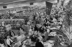 Indiana. September 1957. Busy shoppers with carts in check out line at Eavey supermarket. (Life)