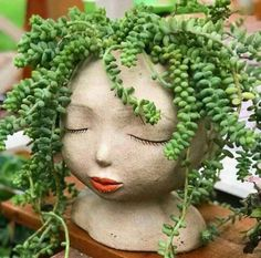 Give your plants a home with this Lady of the Forest head-shaped planter. These plant pots are handcrafted out of resin. Each one is individually painted and may vary slightly. Indoor Garden, Garden Art, Garden Design, Face Planters, Planter Pots, Floating Plants, Pot Jardin, Decoration Plante, House Plants Decor