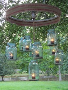 A bike wheel mobile or add glass or metal tubes for make a wind chime! #upcycleyourbicycle