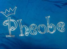 Pheobe written in the curlz font on a sapphire blue hoodie. All done in the clear crystals, with a little clear/hot pink crown. We can make this design in any colour for you and apply it to a huge variety of garments. For more info/pictures you can visit our website or give us a call!
