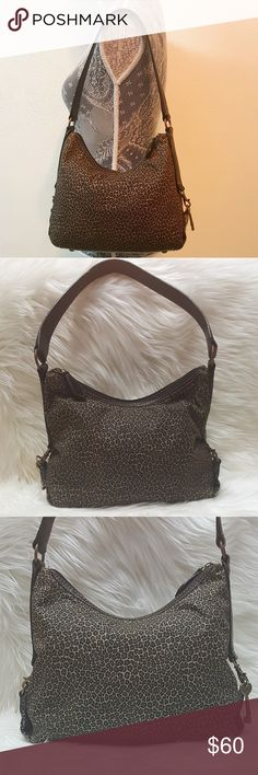 "FOSSIL 1954 cheetah print leather shoulder bag FOSSIL cheetah print leather shoulder bag, one spot of marks in interior lining, fabric is cheetah print, leather strap and bottom  Measurements are approximate  11 x 8 x 4 10"" strap drop height Fossil Bags Shoulder Bags"