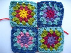 Join Granny squares with single crochet. I love the square's pattern and especially the colors of the square on the top left. Maybe do the same flower look but with black border?
