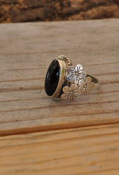 Sterling silver ring black onyx silver ring hibiscus flower ring sterling silver jewelry sizes 4.5 and up DK313 by Andiesvintage on Etsy https://www.etsy.com/listing/247365577/sterling-silver-ring-black-onyx-silver