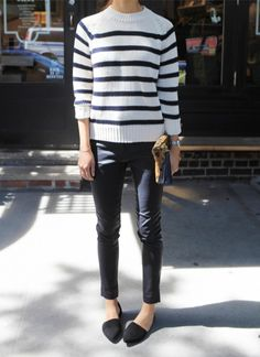 The sweater with simple black jeans and black shoes, so Parisian looking