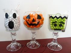 These were so simple! I used dollar store vases and candle-stick holders so these were super inexpensive too! Black vinyl / black electrical tape or black sharpie marker make for cute little faces on these halloween jars! Great for last minute decorations!