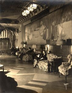 A woman waits in the mezzanine lobby in the 1930s. via Exploring the Forgotten Art Deco Artifacts of the New Yorker Hotel