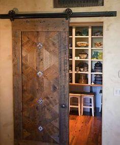 barn door look as opening to pantry