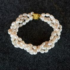 How to make this elegant twisted pearl bracelet with full picture tutorial.