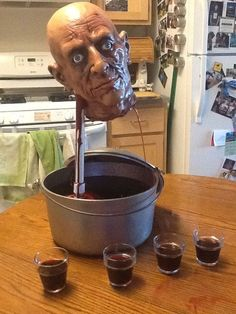 Decapitated Head Drinking Fountain!! This is freaking awesome! Would be perfect for a halloween party to freak people out!