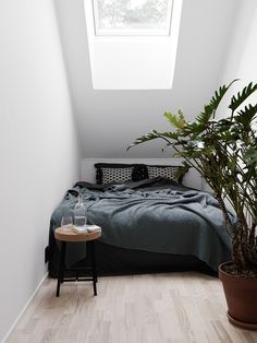 tiny bedroom with slanted ceiling