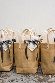WEDDING WELCOME GIFTS// Cream and pewter canvas totes filled with local artisan goods and champaign welcome guests to wedding weekend in Virginia, curated by Marigold & Grey. Wedding Welcome Gifts, Wedding Gift Boxes, Wedding Gifts, Wedding Souvenir, Wedding Favors, Diy Wedding, Wedding Venues, Housewarming Gift Baskets, Gift Box Design