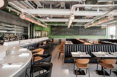 Champeaux, le dernier restaurant d'Alain Ducasse La brasserie Champeaux et son décor signé par le collectif Ciguë. Une esthétique contemporaine, un confort classique.