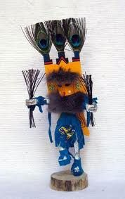"""Photograph; Butterfly Artefact; Kachina Doll. Culture; Navajo. Information; Named after the butterflies that land on flowers and herbs. Butterfly directs the medicine man to ingredients to be used in medicine. The Butterfly Kachina brings together unmarried men and women. During the butterfly social dance, they appear as a pair, one female and one male. Imperial measure; 6"""", 10"""" or 12"""". Price; $39.95 COPYWRITE ©"""