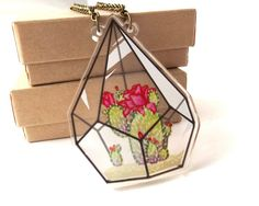 Its a glass bottled terrarium even YOU cant kill! This design features a flowering cactus within a geometric 2D terrarium. This necklace