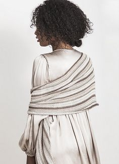 The Windom Silk Wrap has an exquisite blend of color and sheen. Knit with five hanks of Alpaca Silk, this luxurious piece can be worn as a wrap or a scarf. Beautiful drape and stylish stripes, this easy to knit piece is everyday glamour.