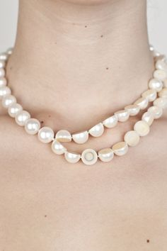 MELANIE GEORGACOPOULOS, SLICED PEARL NECKLACE: single pearl strand short necklace with bisected pearl section and solid 18K gold clasp closure.