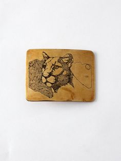 vintage 80s brass belt buckle, mountain lion by 86Vintage86 on Etsy https://www.etsy.com/listing/218249611/vintage-80s-brass-belt-buckle-mountain