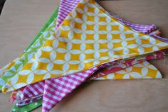 Pink Stitches: DIY Pennant Banner - great way to brighten up the playroom walls!