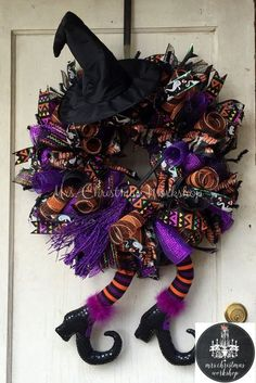 This is a flying witch Halloween wreath made with orange purple and black deco mesh and features a witch hat, broom and witch legs. Wreath measures 24H x 24W not including hat and boots  See more items http://www.etsy.com/shop/mrschristmasworkshop