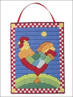 Rooster Plastic Canvas Pattern Download from e-PatternsCentral.com -- Especially appealing for the kitchen, this vividly colored wall hanging can be completed quickly using long stitches.