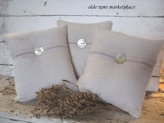 grain sack pillows with vintage buttons