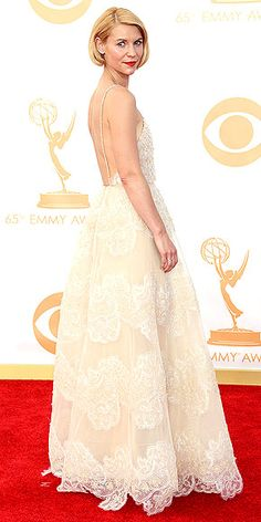CLAIRE DANES Not even Claire's is-it-real-or-is-it-faux bob can steal the attention from her stunning ivory gown, which expertly combines sheer paneling (at the décolletage), lace (down the skirt) and delicate beading (see: the bodice).