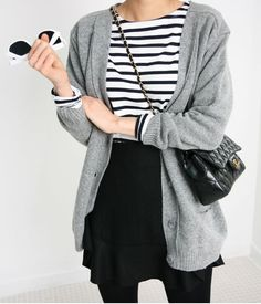 I don't normally wear skirts, but I would wear this look! Love the stripes, black tights, and the versatile grey cardigan to boot.