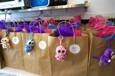 Favor bags provided by the venue get transformed to match the them with some color-coordinated tissue paper, Beanie Boo Keychains and Favor Stickers from Twinspiring Design (www.etsy.com/shop/TwinspiringDesign) that were designed to match the Invitation.