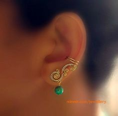simple earring with emerald drop