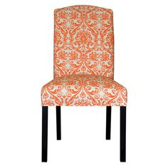 Add a pop of style to your dining room or desk with this eye-catching wood side chair, showcasing a damask motif and cotton upholstery.