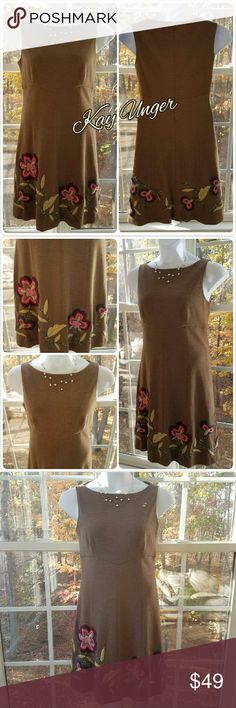 🆕Kay Unger New York 100% Wool Camel Colored Dress Kay Unger Gorgeous 100% Wool Camel Floral Dress  Gorgeous camel colored wool dress with colorful embroidered flower accents on the hemline 100% Wool Dry Clean Only  Sleeveless  Back zippered closure  Measurements to be added  Excellent preloved condition   Please let me know if you have any questions.  Thank you for looking! Xoxoxoxo Kay Unger Dresses