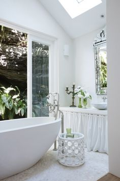 """Rooms that bring the outside in - Vogue Living """"Take a cue from the Indonesians whose bathrooms are almost always open to the outside air. Here, French doors allow a breeze in and green accessories highlight the foliage outside the room so the feeling of a natural environment can still be enjoyed even when the door is closed."""""""